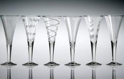 Seis vidrios de licor cristalinos Foto de archivo