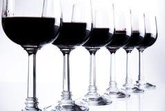 Seis vidros do vinho vermelho Imagem de Stock Royalty Free