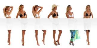Seises jovenes y mujeres atractivas con un cartel en blanco Fotos de archivo libres de regalías