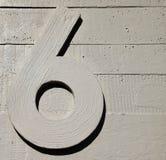 Seises muro de cemento de nueve números fotos de archivo