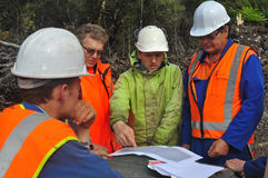 Seismic discussion. Geologists discuss the oil-bearing formation being explored in a seismic reflective survey on the West Coast of New Zealand Stock Photos