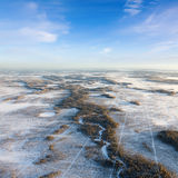 Seismic tracks in winter wooded plain, top view. The Aerial view the river on snow-covered forest plain in time of cold winter day. Network of seismic tracks of Stock Image