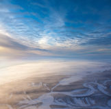 Seismic tracks in winter wooded plain, top view. The Aerial view the river on snow-covered forest plain in time of cold winter day. Network of seismic tracks of Royalty Free Stock Photos