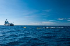 Seismic vessel towing air guns royalty free stock images