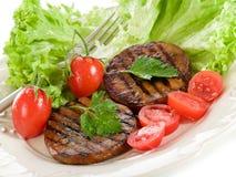 Seitan grelhado com tomates foto de stock