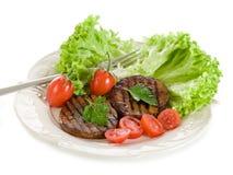 Seitan grelhado com tomates fotos de stock