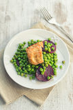 Seitan with peas and beetroots Stock Photos
