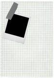 Seite des quadrierten Papiers und unbelegtes Foto Lizenzfreies Stockfoto