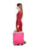 Seitenansicht der gehenden Frau mit Einkaufstaschen Lizenzfreie Stockfotografie