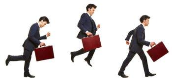 Seitenansicht des Geschäftsmannbetriebs und -c$springens Stockbild