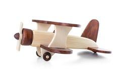 Seitenansicht des hölzernen Flugzeugmodells lokalisiert Lizenzfreies Stockfoto
