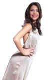 Seitenansicht einer Schönheitsfrau, die an der Kamera lächelt Lizenzfreies Stockfoto