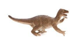 Seitenansichtbraunplastikdinosaurierspielzeug auf weißem Hintergrund Stockbild