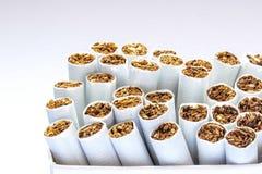 Seitenansichtstapel Zigaretten Lizenzfreie Stockfotos