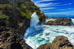 Seixal ocean natural pools and bay at Madeira northern coastline stormy day stock image
