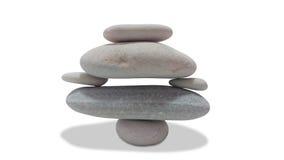 Seixos de equilíbrio isolados no branco Foto de Stock