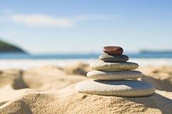 Seixos na areia Foto de Stock Royalty Free