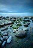 Seixos na baía de Dunraven Foto de Stock