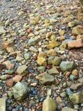 Seixos na costa, Cumbria Fotografia de Stock