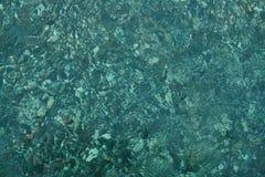 Seixos sob a água Imagem de Stock Royalty Free