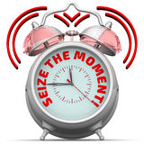 Seize the moment. The alarm clock with an inscription Stock Images
