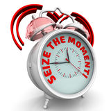 Seize the moment. The alarm clock with an inscription Stock Photography