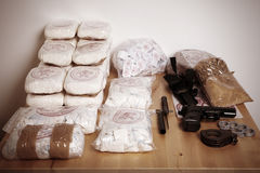 Seized narcotics. Drug packages, raw opium, drug dozens and weapons seized by police Stock Image