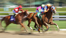 Seizing the Lead. SARATOGA SPRINGS, NY - AUG 27: A jockey takes his mount to the lead in a thoroughbred allowance race at Saratoga Race Course on Aug 27, 2010 in Royalty Free Stock Images