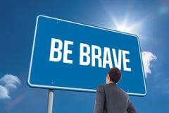 Seja corajoso contra o céu Imagens de Stock