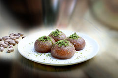 Sekerpare with Antep peanuts. Turkish delights sekerpare plate with pistachios Royalty Free Stock Photography