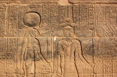 Sekhmet and Amun Ra. Carving on the wall of the Temple of Isis at Philae, Aswan Egypt.  The Ancient Egyptian goddess Sekhmet - depicted with the head of a Stock Photography