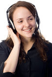 Sekretär mit einem Kopfhörer Lizenzfreies Stockbild