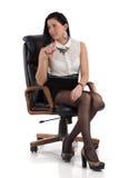 Sekreterareflicka i stolen Arkivfoto