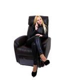 Seksowna blondynka opowiada na telefonie Fotografia Royalty Free