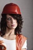 Seksowna dziewczyna w zbawczym hełmie i pomarańczowej kamizelce zdjęcie stock