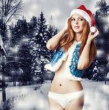 Seksowna kobieta Santa w biały spodniach Claus Obraz Royalty Free