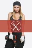 Seksowna kobieta trzyma cordless śrubokręt Remontowa ikona w tło kobiecie zdjęcie royalty free
