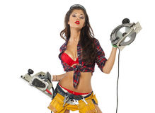 Seksowna młoda kobieta pokazuje budów narzędzia Fotografia Stock