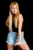 Seksowna młoda kobieta w błękitnych skrótach Obraz Stock