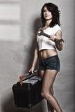 Seksowny dziewczyny mienia toolbox i wyrwania spanner Fotografia Royalty Free