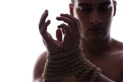 Seksowny mężczyzna z wiązanymi rękami fotografia stock