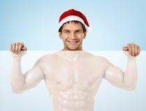 Seksowny mężczyzna Święty Mikołaj Fotografia Royalty Free