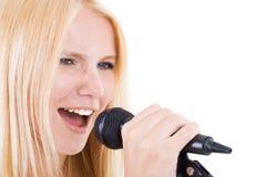 Seksuele blonde en microfoon Royalty-vrije Stock Afbeelding