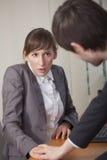 Seksuele kwelling in de werkplaats Royalty-vrije Stock Afbeeldingen