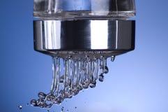 Sel de l'eau dans le bleu Photographie stock
