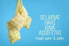 Selamat Hari Raya Aidilfitri Greeting. Caption: Fasting Day of Celebration, I seek forgiveness, physically and spiritually. Copy space on top the wording for royalty free stock images