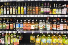 SELANGOR, MALAYSIA - 12 JUNE, 2017: Variety of food vinegar and cooking oil display on rack in hypermart at Puncak Alam, Malaysia Stock Photos