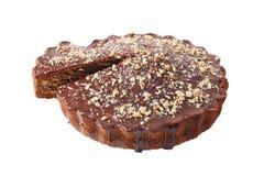 Selbst gemachte besprühte Torte mit einem Stück herausgeschnitten Lizenzfreie Stockfotografie