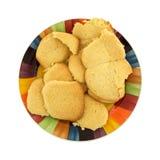 Selbst gemachte Zuckerplätzchen auf buntem Teller Stockfotos