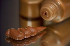 Selbstbräunung, die Lotion bronziert lizenzfreies stockbild